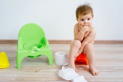 Baby sitting on a potty royalty free stock images