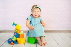 Baby sitting on potty in home interior royalty free stock photo