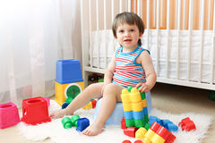 Baby sitting on potty. Baby with toys sitting on potty Royalty Free Stock Images