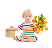 Baby sitting and presenting flowers and box Royalty Free Stock Photo