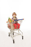 Baby sitting in shopping cart Stock Photo