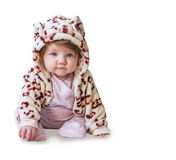 Baby sitting and smiling in a camouflage costume on a white background. Royalty Free Stock Photography