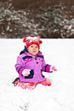 Baby sitting on the snow Royalty Free Stock Photos