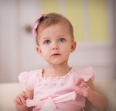 Baby sitting on a sofa Stock Photography