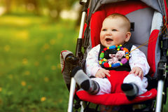 Baby in sitting stroller stock photos