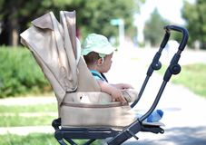 Baby in sitting stroller Stock Photo
