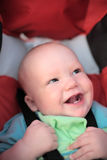Baby sitting in stroller. First teeth Stock Image