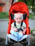 Baby in sitting stroller stock image