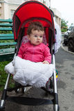 Baby is sitting in stroller Royalty Free Stock Images