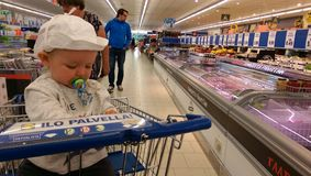 Baby sitting in a supermarket cart