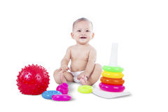 Baby sitting with toys - isolated Royalty Free Stock Photos