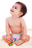 Baby sitting with toys and smile Royalty Free Stock Images