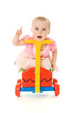 Baby sitting on a trolley Royalty Free Stock Photo
