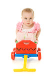 Baby sitting on a trolley Stock Images