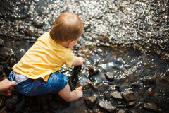 Baby sitting in water Stock Photography