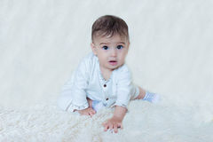 Baby sitting on the white background stock photography