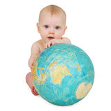 Baby sitting on white background with globe Stock Photography