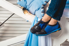 Baby sitting on a white wheel wearing blue jeans and black shoes Royalty Free Stock Photo