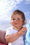 Baby and sky11. Little baby girl and sky royalty free stock photos