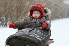 Baby on sled Royalty Free Stock Images