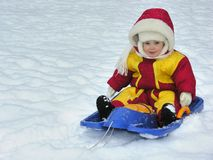 Baby on sled. Winter snow Stock Photography