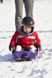 Baby on sled Stock Photos