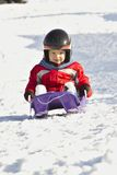 Baby on sled Royalty Free Stock Photos