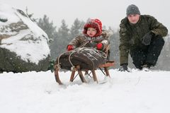 Baby sledding Royalty Free Stock Images