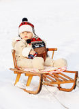 Baby on sledge Royalty Free Stock Photography
