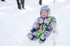 Baby on sledge Stock Image