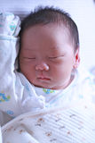 Baby Sleep. Portrait of a little new born baby boy sleep on his bed Royalty Free Stock Photo