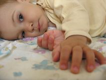 Baby after sleep. With hands Royalty Free Stock Image