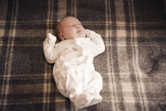Baby sleep. Alone on bed Stock Images