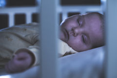 Baby sleep in a baby bed. Royalty Free Stock Photography