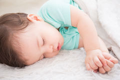 Baby sleep on the bed Stock Photos
