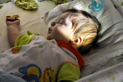 Baby sleep in bed shined sun beam Stock Photo