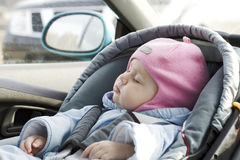 Baby sleep in a car Stock Photo