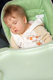 Baby sleep on feeding chair Royalty Free Stock Photos