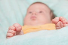 Baby sleep with feet on foreground Stock Images