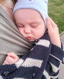 Baby sleep on hands. Baby sleep on his mother`s hands outoodrs Royalty Free Stock Photos