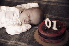 baby sleep near his cake Stock Photography