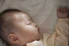 Baby sleep soundly and luminous beam on face Royalty Free Stock Images