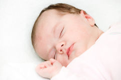 Baby sleep under a white blanket Royalty Free Stock Photo