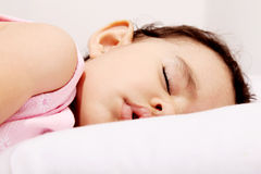 Baby sleeping. Cute baby sleeping on a white pillow Stock Image