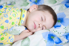 Baby sleeping. Kid dreams of sweet dreams, and fairy worlds Stock Photography