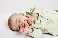 Baby sleeping. Soundly over white background Stock Images