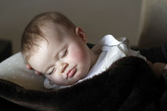 Baby sleeping. Portrait of a baby girl sleeping royalty free stock photos