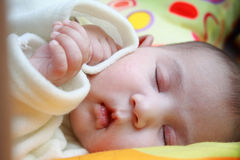 Baby Sleeping. Infant baby girl sleeping in bad Stock Photography