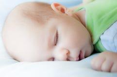 Baby sleeping. A baby boy is sleeping on blue blanket Royalty Free Stock Photos