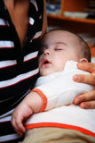 Baby sleeping. In mother's harms Royalty Free Stock Photo